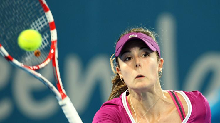 Alize Cornet of France plays a shot in her match against  Serena Williams of the U.S. during the Brisbane International tennis tournament in Brisbane, Australia, Tuesday, Jan. 1, 2013.  (AP Photo/Tertius Pickard)