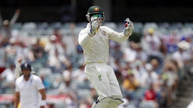 Australia's Brad Haddin jumps in the air after taking a catch on the fifth day of their Ashes cricket test match against England in Perth, Australia, Tuesday, Dec. 17, 2013. (AP Photo/Theron Kirkman)