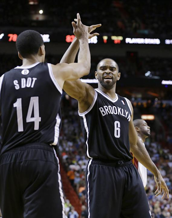 Brooklyn Nets forward Alan Anderson (6) congratulates guard Shaun Livingston (14) after Livingston scored during the second half of an NBA basketball game against the Miami Heat, Wednesday, March 12,