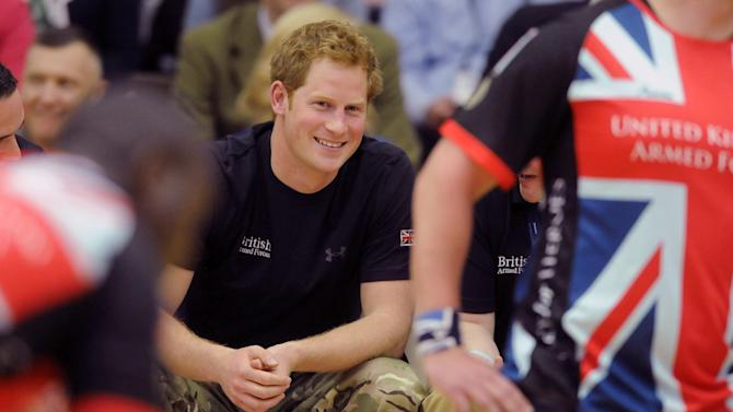 Britain's Prince Harry watches a sitting volleyball with the United Kingdom team at a visit to the Warrior Games opening, Saturday, May 11, 2013 in Colorado Springs, Colo.  The Warrior Games is a Paralympic-style competition featuring injured servicemen and women from the U.S., United Kingdom, Canada and Australia. (AP Photo/The Colorado Springs Gazette, Jerilee Bennett) MAGS OUT