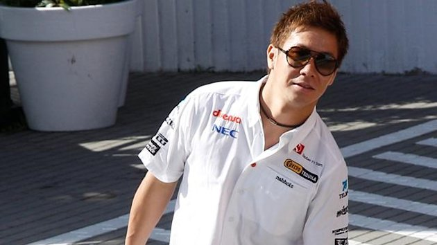 Sauber Formula One driver Kamui Kobayashi of Japan arrives for the third practice session of the Hungarian F1 Grand Prix