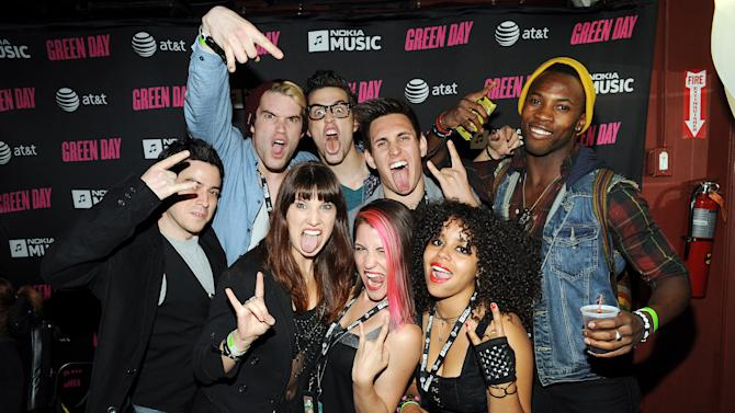 "The cast of the musical ""American Idiot"" attends the Green Day performance celebrating the launch of Nokia Music with AT&T at Irving Plaza on Saturday, Sept. 15, 2012 in New York. (Photo by Scott Gries/Invision for Nokia/AP Images)"