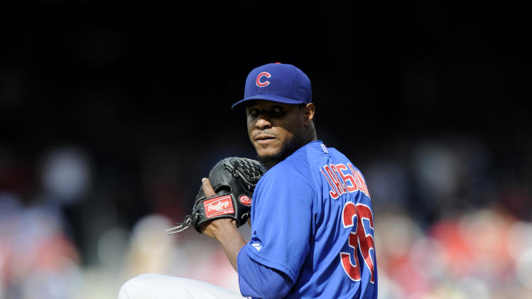 Chicago Cubs starting pitcher Edwin Jackson winds up to deliver a pitch against the Washington Nationals during the first inning of a baseball game, Saturday, May 11, 2013, in Washington. (AP Photo/Nick Wass)