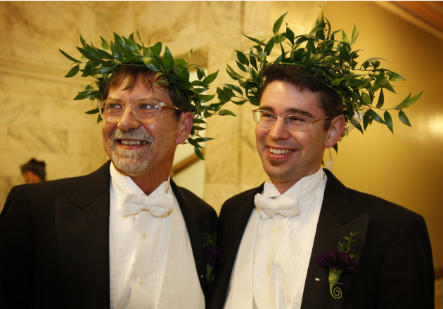 Steven Jones, left, and Jamous Lizotte wear laurel wreaths as they arrive at City Hall to obtain a marriage license, Friday, Dec. 28, 2012, in Portland, Maine. Same-sex couples in Maine will be allowe