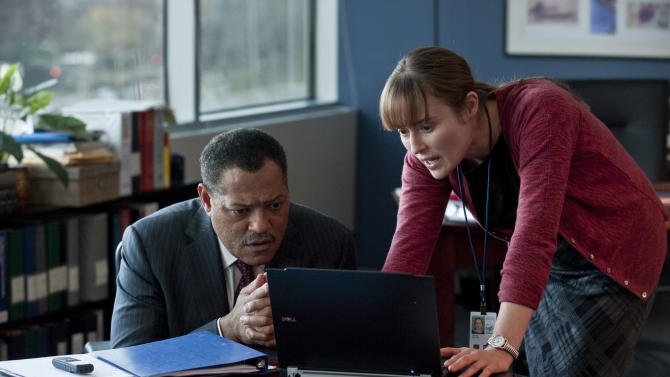 "In this image released by Warner Bros. Pictures, Laurence Fishburne, left, and Jennifer Ehle are shown in a scene from the film ""Contagion."" (AP Photo/Warner Bros. Pictures, Claudette Barius)"