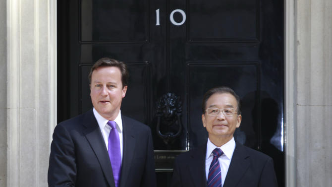 Britain's Prime Minister David Cameron, left, shakes hands with China's Prime Minister Wen Jiabao, right, at his official residence, 10 Downing Street, in central London, prior to their meeting, Monday, June 27, 2011. (AP Photo/Lefteris Pitarakis)