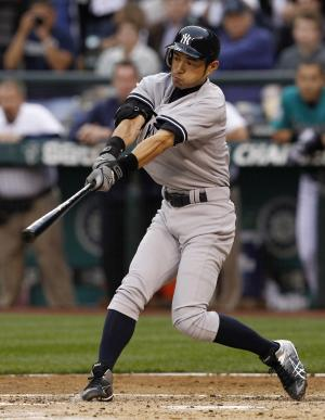 New York Yankees' Ichiro Suzuki singles against the Seattle Mariners in the third inning of a baseball game Monday, July 23, 2012, in Seattle. (AP Photo/Elaine Thompson)