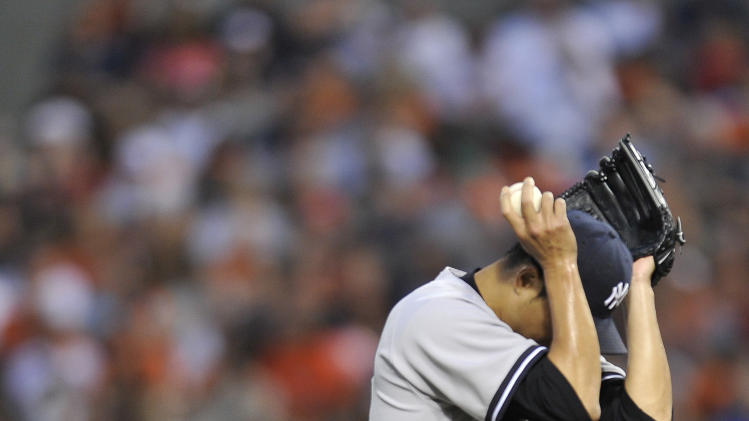New York Yankees pitcher Hiroki Kuroda reacts after giving up a solo home run to the Baltimore Orioles in the first inning of a baseball game, Sunday, June 30, 2013, in Baltimore. (AP Photo/Gail Burton)