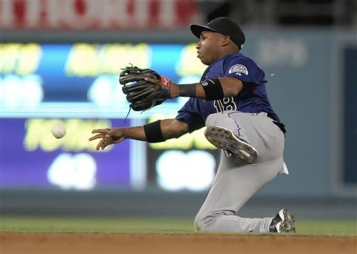 Rutledge leads Rockies over Dodgers 3-1