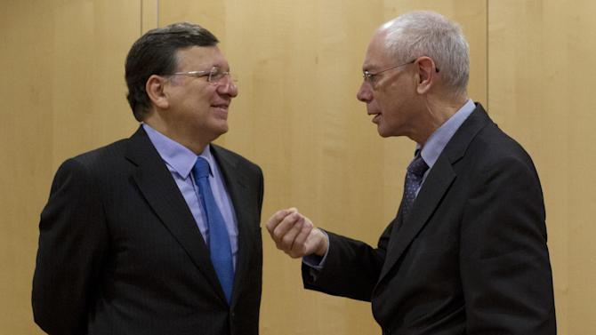 European Commission President Jose Manuel Barroso, left, speaks with European Council President Herman Van Rompuy during a meeting at EU headquarters in Brussels on Tuesday, Nov. 13, 2012. (AP Photo/Virginia Mayo)