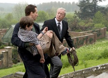 Linus Roache as Thomas Wayne, Gus Lewis as Young Bruce Wayne and Michael Caine as Alfred Pennyworth in Warner Bros. Pictures' Batman Begins