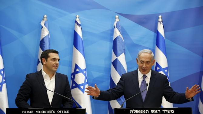 Israeli Prime Minister Netanyahu gestures as he delivers a joint statement with his Greek counterpart Tsipras in Jerusalem