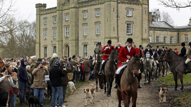 Members of the Old Surrey Burstow and West Kent Hunt leave Chiddingstone Castle for the annual Boxing Day hunt in Chiddingstone, south east England