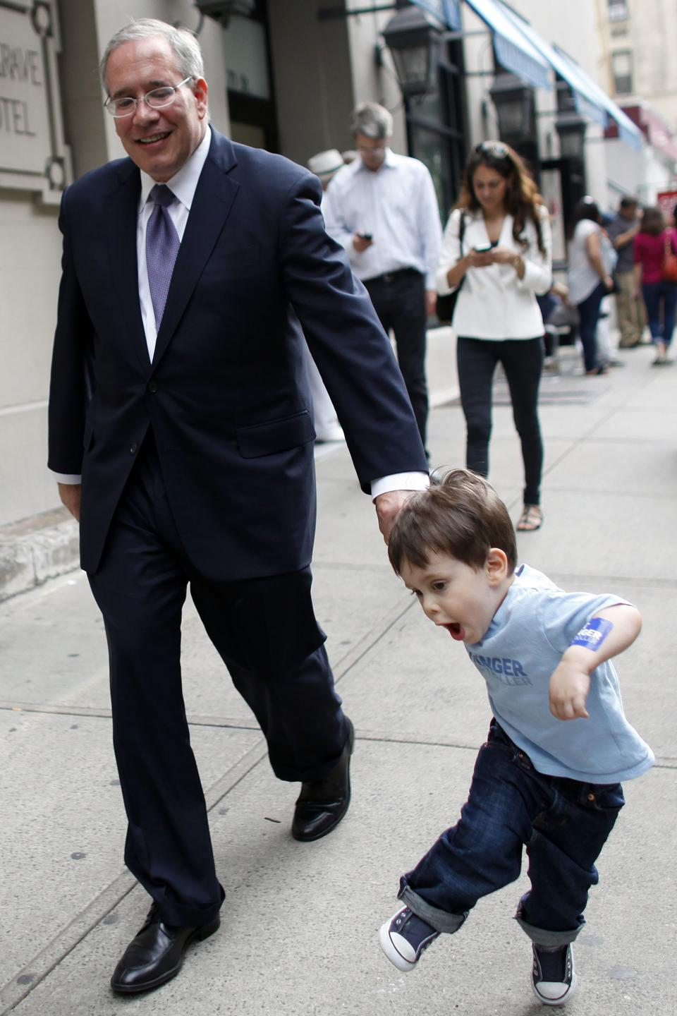 Manhattan Borough President Scott Stringer leaves a polling station with his 20-month old son Max after casting his ballot during the primary election, Tuesday, Sept. 10, 2013, in New York. Stringer is running against Ex-Gov. Eliot Spitzer for city comptroller. (AP Photo/Jason DeCrow)