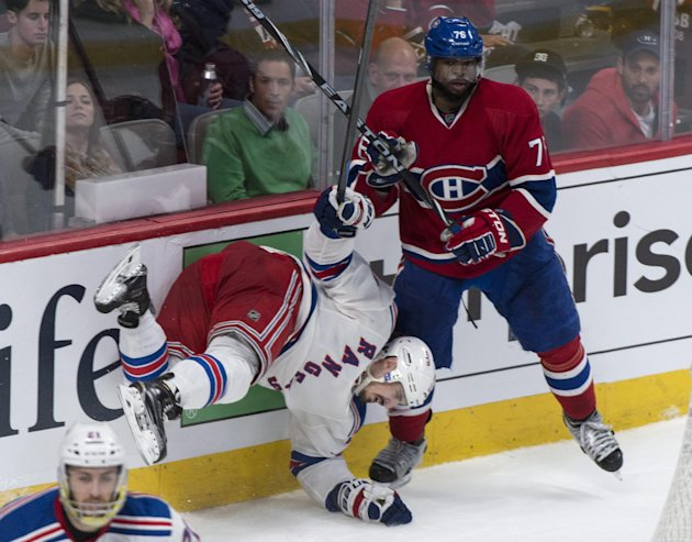 New York Rangers' Chris Kreider falls in front of Montreal Canadiens' P.K. Subban during the third period of Game 5 of the NHL hockey Stanley Cup play...