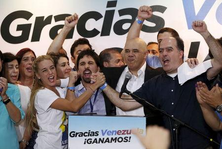 Lilian Tintori, wife of jailed Venezuelan opposition leader Leopoldo Lopez, celebrates next to candidates of the Venezuelan coalition of opposition...