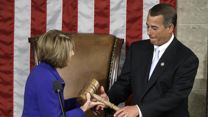 FILE - This Jan. 5, 2011 file photo shows then-outgoing House Speaker Nancy Pelosi of Calif. handing the gavel to the new House Speaker John Boehner of Ohio during the first session of the 112th Congress on Capitol Hill in Washington. Democratic candidates for the House pulled off a dubious feat in the 2012 election: Collectively, they got more votes than their Republican opponents, but they didn't win the most seats. It was only the second time since World War II that the party receiving the most votes failed to win a majority of seats in the House. The other time was 1996, and the scenario was similar (AP Photo/Charles Dharapak, File)