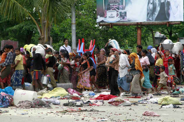 Muslims villagers are relocated to secure areas in Sittwe, capital of Rakhine state in western Myanmar, where sectarian violence are ongoing Tuesday, June 12, 2012. Gunshots rang out and residents fle