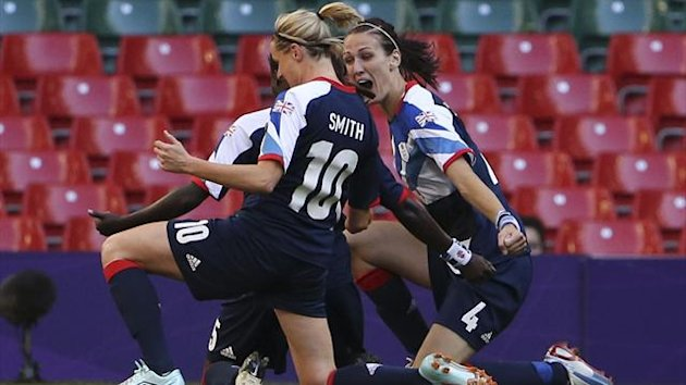 Great Britain celebrate Jill Scott's goal against Cameroon at the Olympics