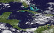 <p>A GOES-East satellite photo of Ernesto in the Caribbean on August 5. Ernesto gained strength as it churned toward landfall on the Yucatan peninsula packing top sustained winds of 85 miles per hour (130 kmh), the National Hurricane Center said.</p>