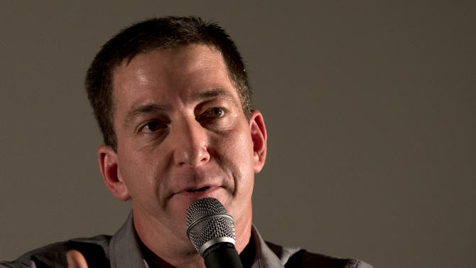 """Journalist Glenn Greenwald talks during a panel following the screening of the """"Dirty Wars"""" documentary at the Rio Film Festival in Rio de Janeiro, Brazil, Saturday, Sept. 28, 2013. Greenwald, who has thousands of leaked National Security Archive documents, participated on a panel with American journalist Jeremy Scahill following the screening of the documentary """"Dirty Wars"""" based on his book by the same name about covert operations. (AP Photo/Silvia Izquierdo)"""