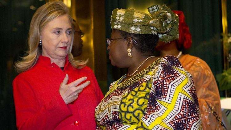 Secretary of State Hillary Rodham Clinton talks with Nigerian Finance Minister Ngozi Okonjo-Iweala, at the Presidential Villa in Abuja, Nigeria, Thursday, Aug. 9, 2012. (AP Photo/Jacquelyn Martin, Pool)