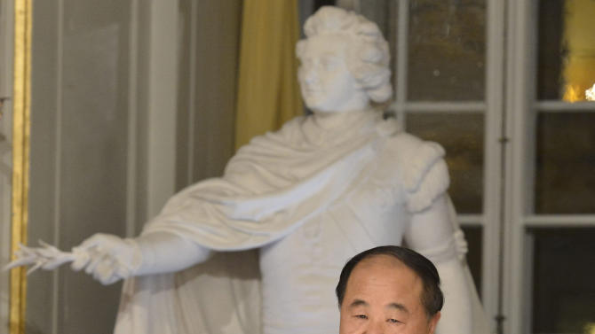 The 2012 Nobel Literature Prize laureate, Mo Yan of China speaks during the traditional Nobel lecture Friday Dec. 7, 2012 at the Royal Swedish Academy in Stockholm, Sweden. (AP Photo/Jonas Ekstromer)