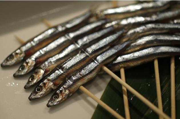 Skewers of dried banded blue-sprats are seen at the Akasaka Umaya Japanese-style restaurant in Tokyo