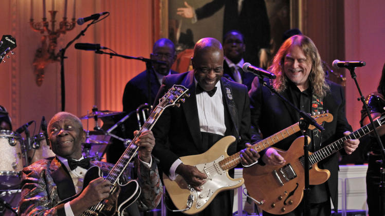 B.B. King, left, Buddy Guy from Chicago, and Warren Haynes, right, perform during the White House Music Series saluting Blues Music in recognition of Black History Month, Tuesday, Feb. 21, 2012, in the East Room of the White House in Washington. (AP Photo/Pablo Martinez Monsivais)