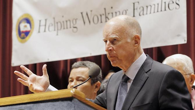 California Gov. Jerry Brown speaks prior to signing a bill raising the California minimum wage in Los Angeles Wednesday, Sept. 25, 2013. Brown has put his signature on a bill that will hike California's minimum wage to $10 an hour within three years. The legislation signed Wednesday will raise the current minimum of $8 an hour to $9 on July 1, 2014, and then to $10 on Jan. 1, 2016. (AP Photo/Nick Ut)