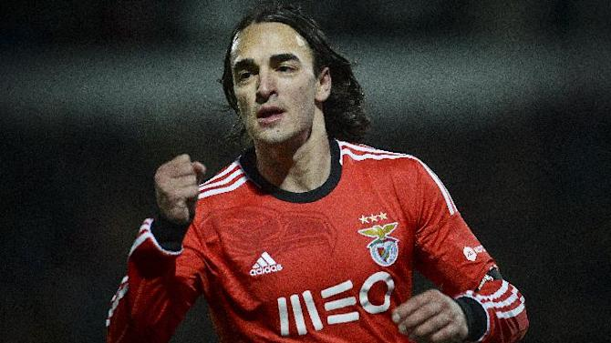 Benfica's Serbian midfielder Lazar Markovic celebrates after scoring against Pacos de Ferreira during the Portuguese league football match Pacos de Ferreira vs SL Benfica at Mata Real stadium in Pacos de Ferreira on February 16, 2014