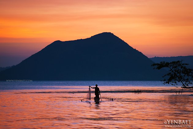 Taal Volcano as seen from Talisay, Batangas. Fishers and farmers live on and around Volcano Island despite the risk of eruptions. (Yen Baet)