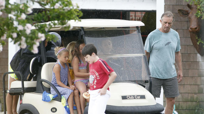 Robert F. Kennedy Jr.,, right, is seen with relatives at his home in Hyannis Port, Mass., Saturday, Aug. 2, 2014. Kennedy is to wed actress Cheryl Hines at the Kennedy Compound in Hyannis Port later tin the day. (AP Photo/Stew Milne)