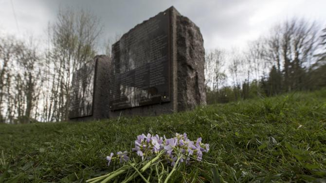 A bouquet of flowers is placed near two memorial stones near the gas chamber at the former WWII concentration camp of Natzwieler-Struthof