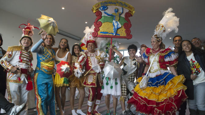 "File-in this Thursday, Dec. 6, 2012 file photo, Brazilian dancers pose for a group photo at the UNESCO headquarters in Paris. The frenetic music and vibrant colors of the Frevo, a Brazilian carnival dance, have been immortalized by UNESCO as a world heritage treasure. The electrifying tradition from the city of Recife will now stand alongside the likes of the Argentine Tango, Spanish Flamenco and the French gastronomic meal _ under UN protection as a piece of ""intangible heritage."" (AP Photo/Michel Euler)"