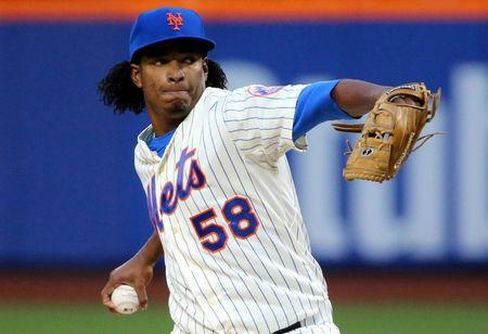 New York Mets Jenrry Mejia delivers a pitch during the first inning against the Miami Marlins at Citi Field in New York