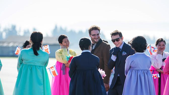 "This photo provided by Columbia Pictures - Sony shows, Seth Rogen, center, as Aaron, and James Franco, as Dave, arriving in North Korea to a welcoming crowd in a scene from Columbia Pictures' ""The Interview."" (AP Photo/Columbia Pictures - Sony, Ed Araquel)"