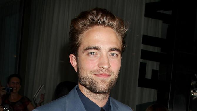 "This Monday, Aug. 13, 2012 photo released by Starpix shows actor Robert Pattinson attending the premiere of ""Cosmopolis"" at the Museum of Modern Art in New York.  (AP Photo/Starpix, Dave Allocca)"
