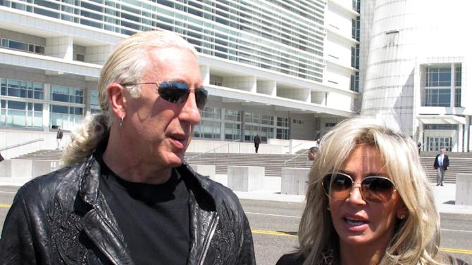 Dee Snider, lead singer of the rock band Twisted Sister, stands with his wife Suzette Snider outside U.S. District Court in Central Islip, N.Y., on Wednesday, April 24, 2013. The couple attended the sentencing of a man convicted of conspiracy and murder in the deaths of Suzette Snider's brother and two other men.(AP Photo/Frank Eltman)
