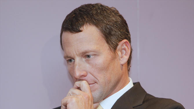 FILE - This Feb. 28, 2011 file photo shows Lance Armstrong listening to a fellow cancer survivor during a news conference in Los Angeles.. The world may soon know what the U.S. Anti-Doping Agency has on Armstrong. USADA has said it had 10 former teammates ready to testify against Armstrong before he chose not to take his case to an arbitration hearing. The list likely includes previous Armstrong accusers Floyd Landis and Tyler Hamilton.  (AP Photo/Damian Dovarganes, File)