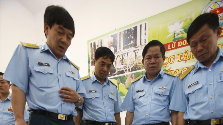 Vietnam Air Force's Deputy Chief of Staff Do Duc Minh points to a map of a search area to find the missing Malaysia Airlines flight MH370, during a news briefing at a military airport in Ho Chi Minh city