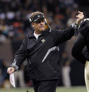 """FILE - In this Dec. 12, 2010 file photo, New Orleans Saints defensive coordinator Gregg Williams gestures in the second half of an NFL football game aainst the St. Louis Rams, in New Orleans. A newly released recording purports to capture former Saints defensive coordinator Williams telling players to """"put a lick"""" on San Francisco's Kyle Williams to see if the receiver has lingering effects from an earlier concussion. (AP Photo/Gerald Herbert, File)"""