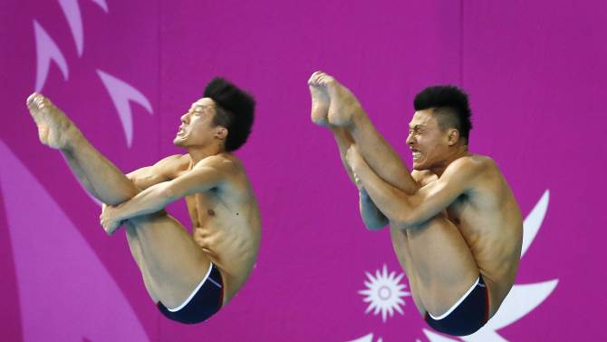 Japan's Okamoto and Terauchi compete in the men's 3m synchronised springboard diving final at the Munhak Park Tae-hwan Aquatics Center during the 17th Asian Games in Incheon