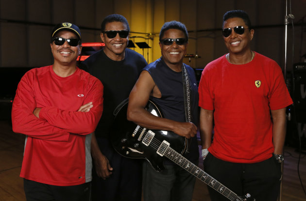 FILE - This June 12, 2012 file photo shows, from left, Marlon Jackson, Jackie Jackson, Tito Jackson and Jermaine Jackson during a rehearsal in Burbank, Calif. Nearly three years after Michael Jackson died while staging his comeback, four of his brothers - Marlon, Jermaine, Tito and Jackie - are preparing for their own return to the stage. (Photo by Todd Williamson/Invision/AP)