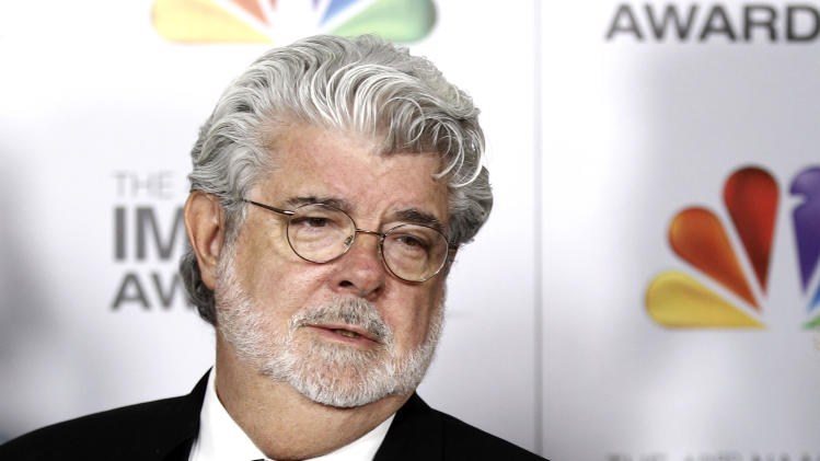 "FILE - In this Feb. 17, 2012 file photo, George Lucas arrives at the 43rd NAACP Image Awards in Los Angeles. A decade after George Lucas said ""Star Wars"" was finished on the big screen, a new trilogy is destined for theaters after The Walt Disney Co. announced Tuesday, Oct. 30, 2012, that it was buying Lucasfilm Ltd. for $4.05 billion.  (AP Photo/Matt Sayles File)"