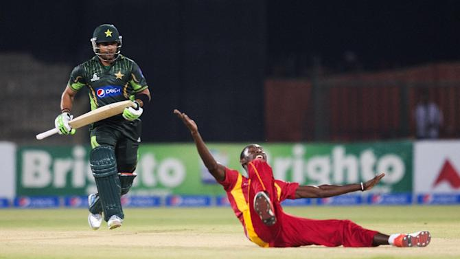 Zimbabwe's Christopher Mpofu celebrates dismissal of Pakistan's Umar Akmal during a match at the Gaddafi Stadium in Lahore, Pakistan, Sunday, May 24, 2015. The Twenty20 matches Friday and Sunday mark a return of international cricket to Pakistan for the first time since gunmen attacked buses carrying the Sri Lankan cricket team and match officials in this eastern city six years ago. Security has been beefed up for the matches. (AP Photo/B.K. Bangash)