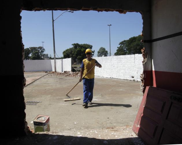 A worker is seen at the grounds of the Flamengo Sport Club, as it is being refurbished to be used by South Korea's national soccer team as its training base during the 2014 World Cup, in Foz do Ig