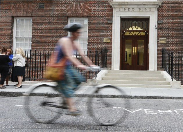 A cyclist passes the Lindo Wing of St Mary's Hospital where Catherine, Duchess of Cambridge is due to give birth in London