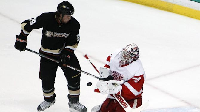 Detroit Red Wings goalie Jimmy Howard blocks a shot by Anaheim Ducks left wing Matt Beleskey during the first period in Game 5 of their first-round NHL hockey Stanley Cup playoff series in Anaheim, Calif., Wednesday, May 8, 2013. (AP Photo/Chris Carlson)