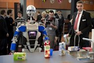 A robot said to be able to cook takes stock of groceries at CeBIT, the world&#39;s biggest high-tech fair on March 6, 2012 in Hanover, Germany. Water-powered clocks, eye-controlled arcade games and pole-dancing robots: this year&#39;s CeBIT tech fair, the world&#39;s biggest, showcased gadgets ranging from the useful to the downright nerdy